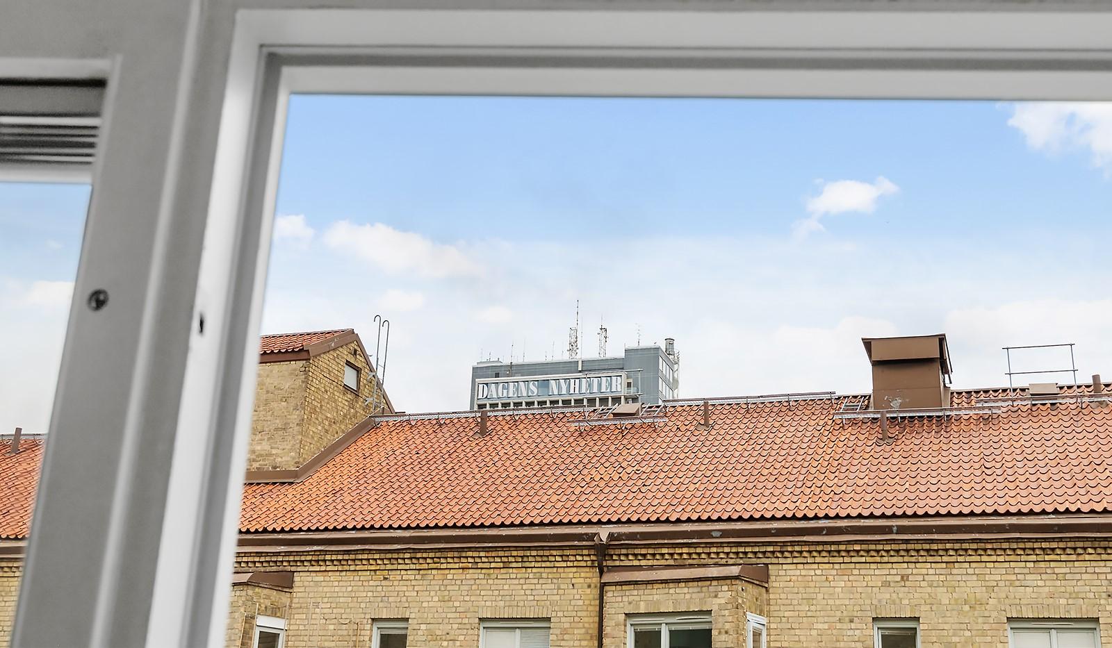 Wennerbergsgatan 6B, 5 tr - DN-huset sticker upp ovan takåsarna